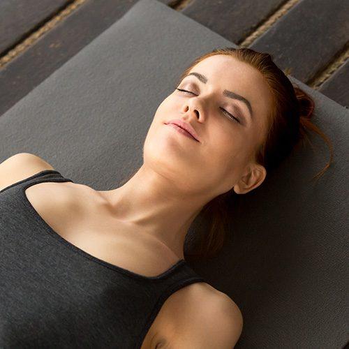 Woman with her eyes closed, Savasana pose