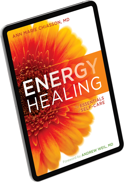 e-book of Energy Healing by Dr. Ann Marie Chiasson on a floating pad
